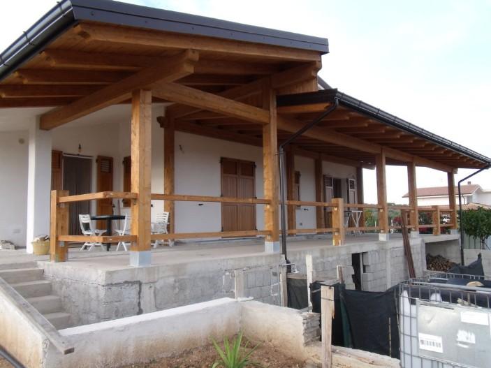 Tettoia in legno coperture in legno lamellare for Montaggio onduline